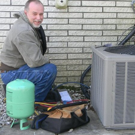 Billy Butler, Owner, Works on a Heat Pump.