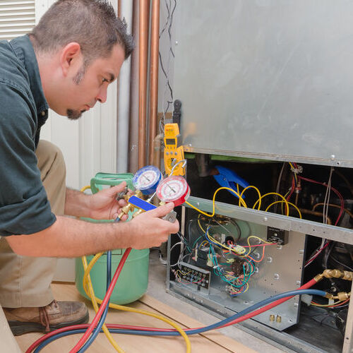 A Technician Provides a Refrigerant Recharge.