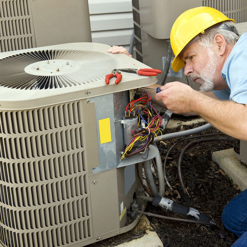 A Technician Provides Air Conditioning Service.
