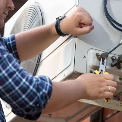 A Technician Provides Emergency AC Repair